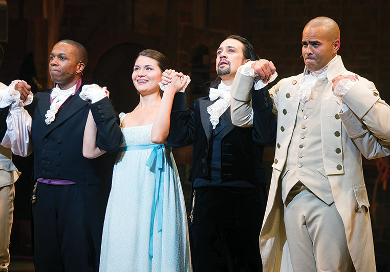 """Leslie Odom Jr., from left, Phillipa Soo, Lin-Manuel Miranda and Christopher Jackson appear at the curtain call following the opening night performance of """"Hamilton"""" at the Richard Rodgers Theatre on Thursday, Aug. 6, 2015, in New York. (Photo by Charles Sykes/Invision/AP)"""