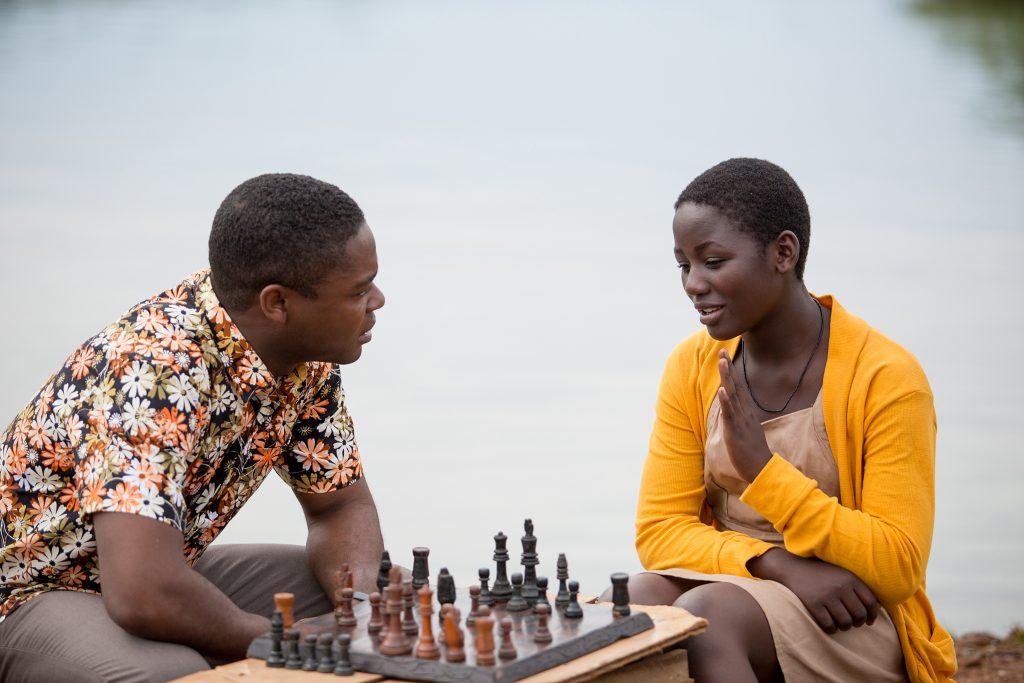 David Oyelowo is Robert Katende and Madina Nalwanga is Phiona Mutesi in Disney's QUEEN OF KATWE